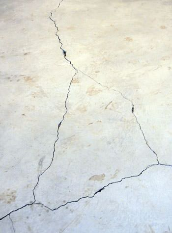 severely cracked, heaving slab floors in a home in Corinth