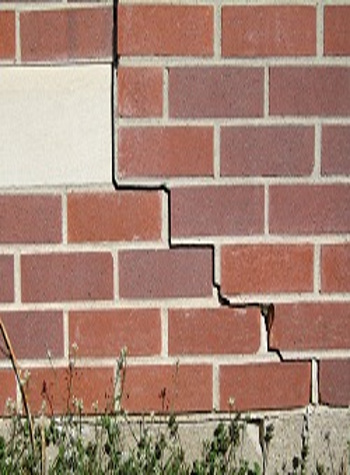 photo of a rotating foundation wall with cracks in Brandon