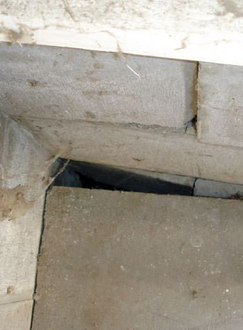 inward rotation of a foundation wall damaged by street creep in a garage in West Memphis