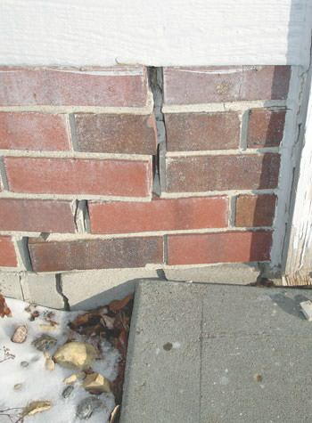 Severe street creep damage to a garage wall outside a Batesville home