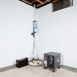 Sump pump system, dehumidifier, and basement wall panels installed during a sump pump installation in Oxford